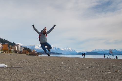 donna cheering in front of lake nahuel huapi