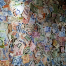The cafe had bills from around the world pinned to its walls...