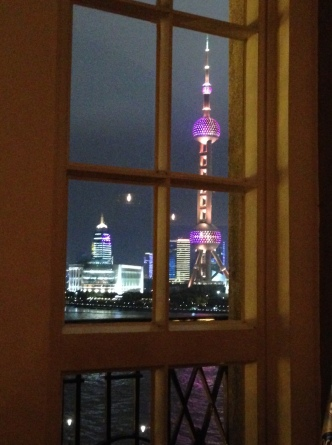 Enjoying a nice meal along the Bund with a light show across the river