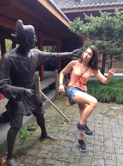 Practicing my kungfu moves with the ancient stone statue. Statue 1, Donna 0.