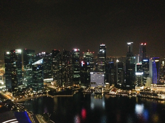 View from the top of Marina Bay Sands at Ku De Ta overlooking the Singapore cityscape
