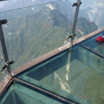 The glass walkway above the mountains.