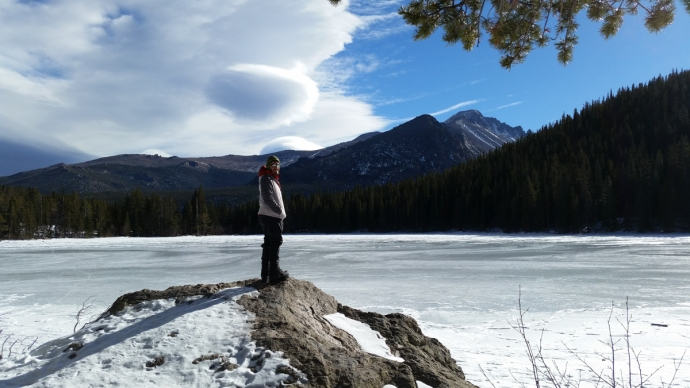 Dominic looking stoically out towards Longs Peak with a frozen Bear Lake in the foreground