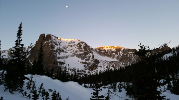 Alpenglow hitting the crest of Notchtop Mountain