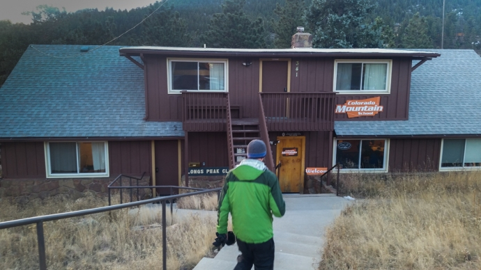 Colin walking towards the entrance of the Colorado Mountain School in Estes Park