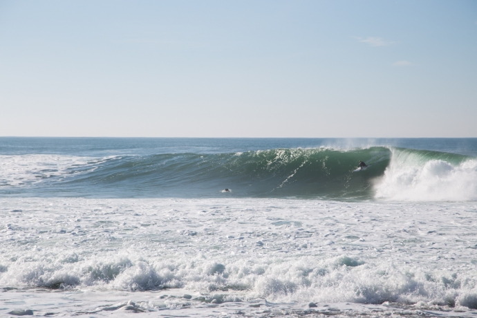 Coxos on the day I surfed it, with a local speed lining the beginning barrel section