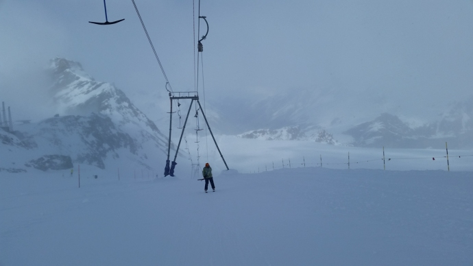 This was by far the longest poma lift I'd ever ridden. Because the tram was closed, we had to take this thing for like 30 minutes to get to the Italian side, which was completely foggy anyway, with wet snow to boot
