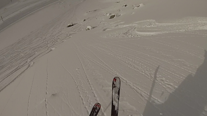 A screen grab from Chris' helmet cam as he descends the powder face we milked 3 runs on