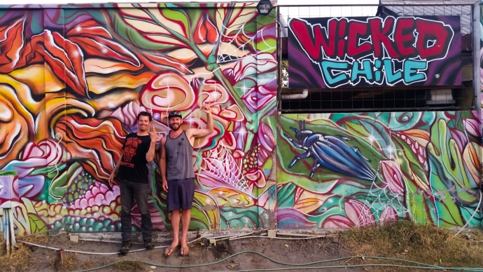 Posing in front of the mural at the Wicked Vans site in Santiago