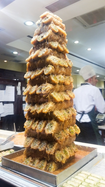 A tower of caramel sugar dripping baklava