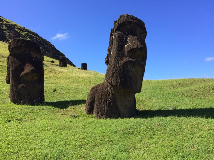 Moai looming at Rano Raraku, which is the location where all the moai were carved from the soft lava rock found near this volcanic crater