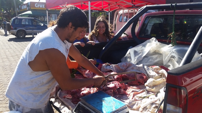 Watching a local cut meat out of the back of his pickup on the main drag in Honga Roa