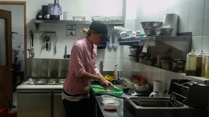 Matti working in the kitchen of her sandwicheria