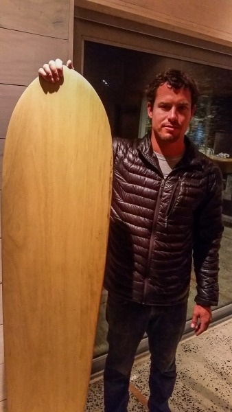 Posing with an alaia that I found in the house. I've always wanted to try surfing one of these.
