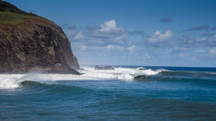 A big set coming in at Mataveri during the peak of the swell. The rock island out there is about 3/4 a mile away. There are only 4 waves in this photo... very long period energy. The waves are like 20+ feet on the faces and breaking top to bottom. An amazing sight.