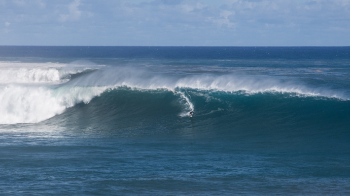 Here's some perspective for you on the size out there. Uti Araki, towed in by Rene.