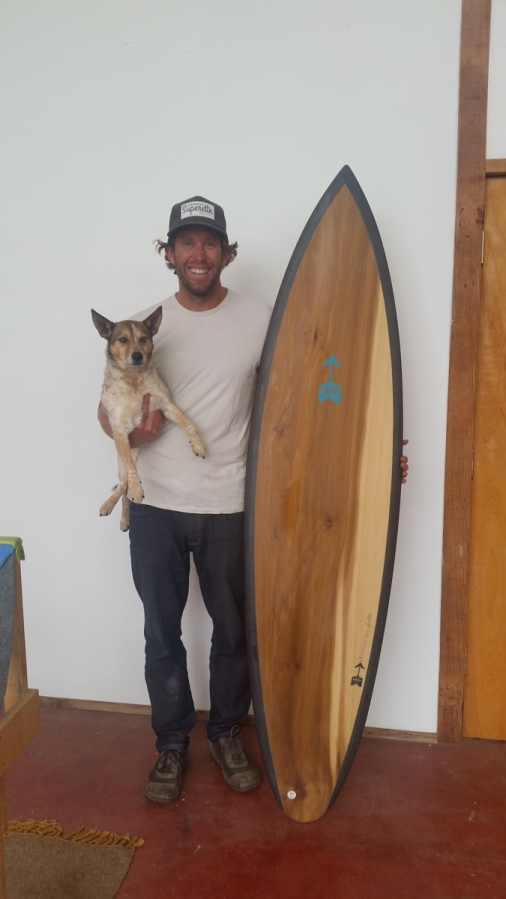 "I ran into Danny Hess just after visiting 3 surf shops looking for a good 6'8"" to buy for my trip to Chile. He told me he had one board -- exactly a 6'8"" -- for sale from a recent batch. It is the ""Banjo"" model, and this is Danny (who is 6'4"") holding his dog, Banjo, while posing next to the board"